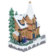 side view of christmas church ornament decorated with garland and featuring a snow covered roof