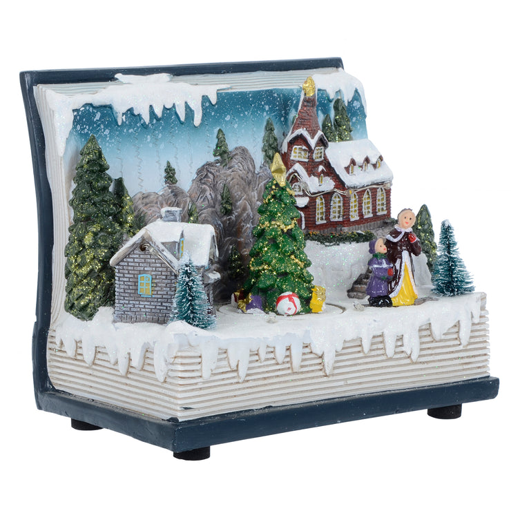 side view of christmas book village scene