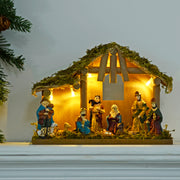 Light up nativity decoration on fireplace ledge