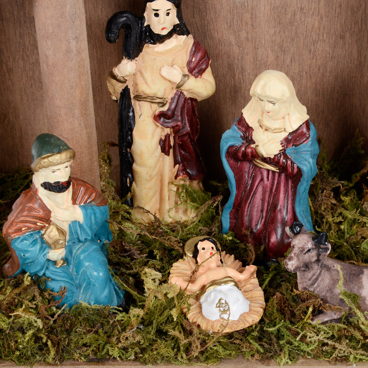 detail shot of characters including mary, baby jesus, donkey, shepherd and king