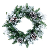 front view of christmas wreath featuring flocked branches and pine cones