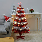 red and white 4ft striped tree with fibre optics and colour changing star in lounge setting