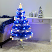 blue and white 4ft striped tree with fibre optic lights and star topper in lounge setting