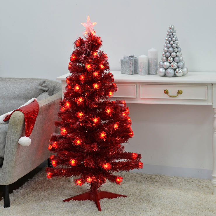 4ft pre-lit fibre optic christmas tree in red finish in lounge setting