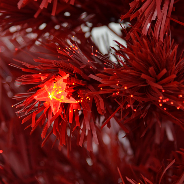 close up of red fibre optic and star shaped lights