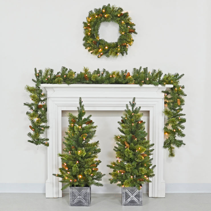 4 piece christmas decoration set with wreath, garland, topiary trees