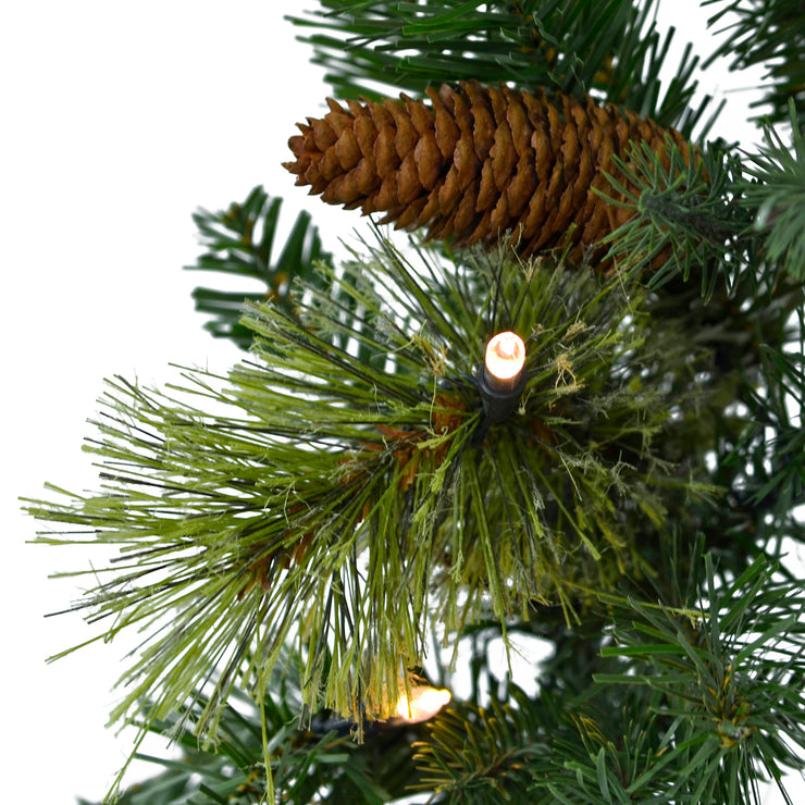 mixed foliage branches with warm white led lights and pine cones
