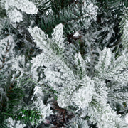 close up detail of luxury snow flocked pine tree branches