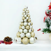 gold and silver 34cm tree decoration on console table in room