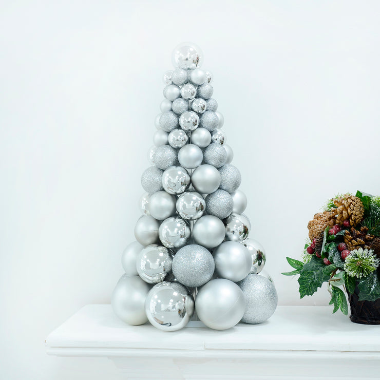 silver tree shaped bauble decoration on fireplace mantel