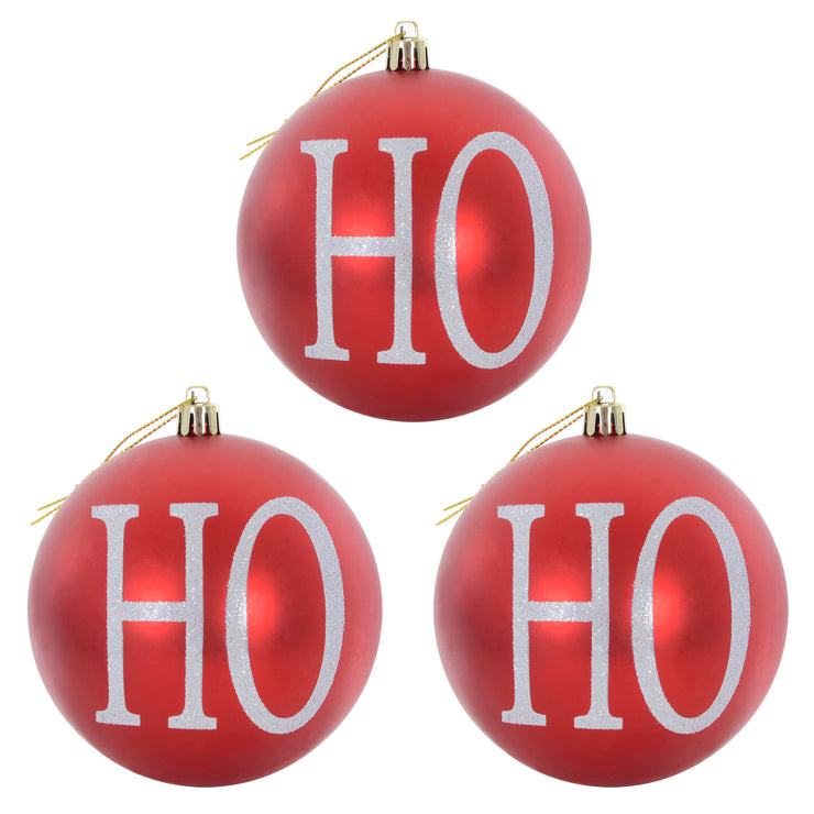 3 pack of 'Ho Ho Ho' design christmas trees featuring a red finish, with white lettering and silver glitter