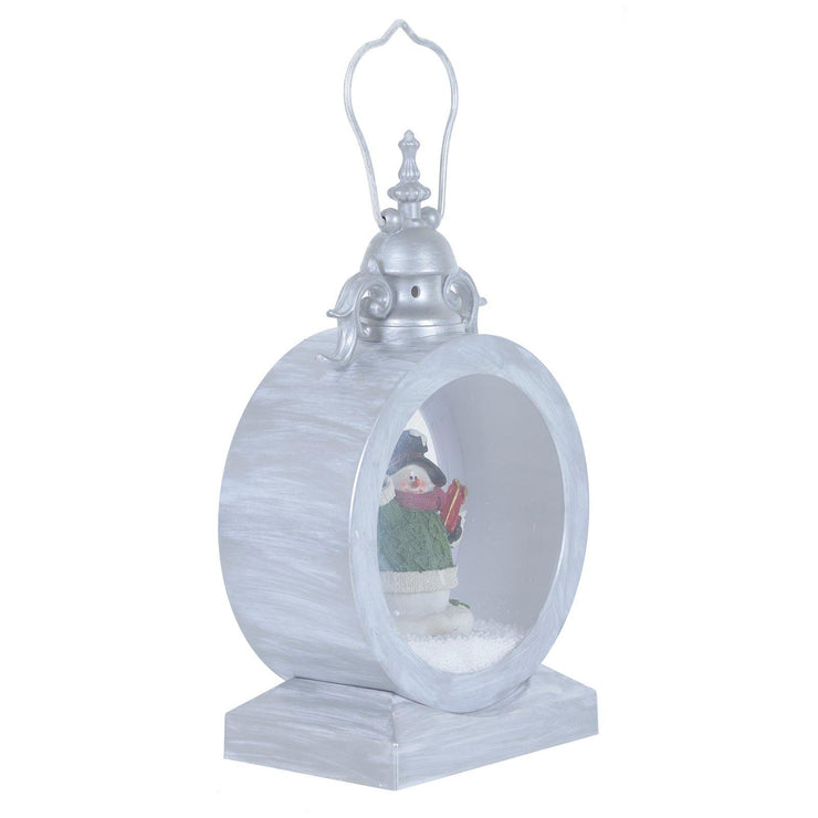 side view of antique silver style latern featuring vintage detailing and a handle
