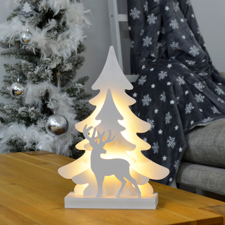 reindeer and tree warm white decoration on coffee table in living room