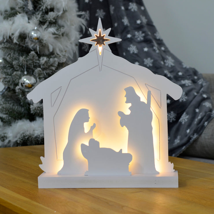nativity scene decoration with warm white lights on coffee table in sitting room