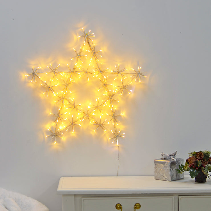 twinkling LED cluster star light decoration on wall in living room