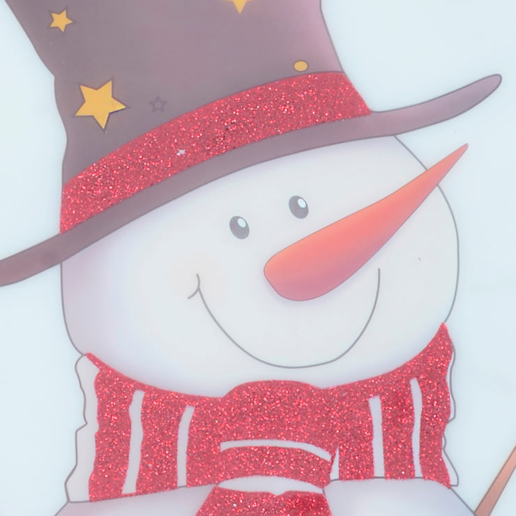 close up of snowman sticker featuring red glitter hat rim and scarf