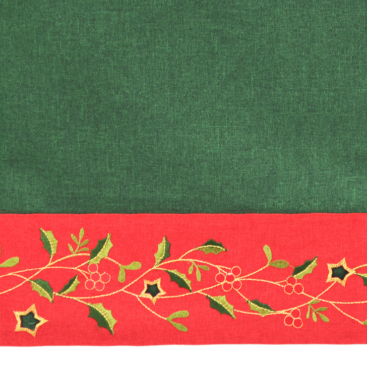 close up of embroidered holly and berry leave design with gold stars and two shade green leaves