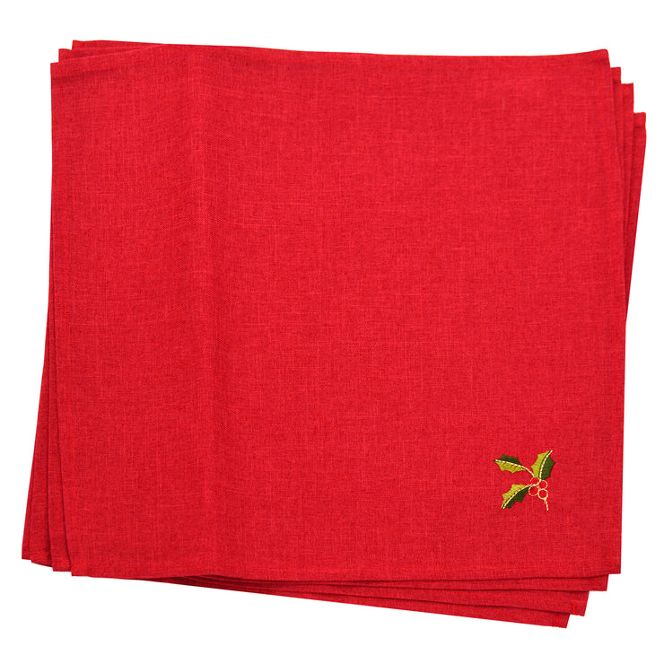 set of 4 red napkins with embroidered holly and berry leaves in the corner