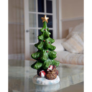 christmas tree resin ornament on coffee table in living room
