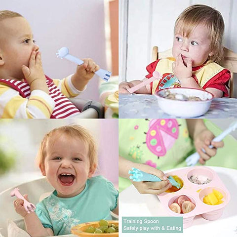Baby eating using training spoon and fork