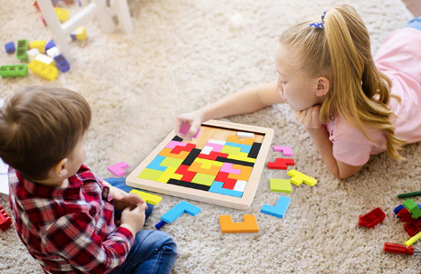 Children Playing Tetris Puzzle Game
