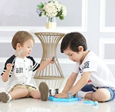 Two boys inserting ice tray into the plate for playing pinguin ice block trap game