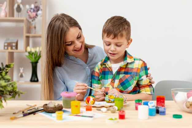 young mom sonpainting egg easter