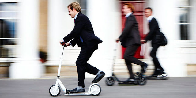 Men scooting the commute with Micro Scooters