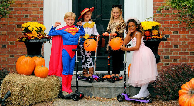 Kids scooting their trick or treat
