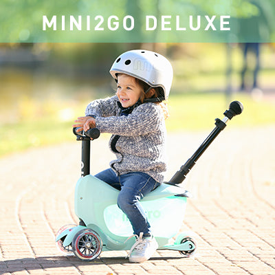 Preschooler on her Mini2go Deluxe