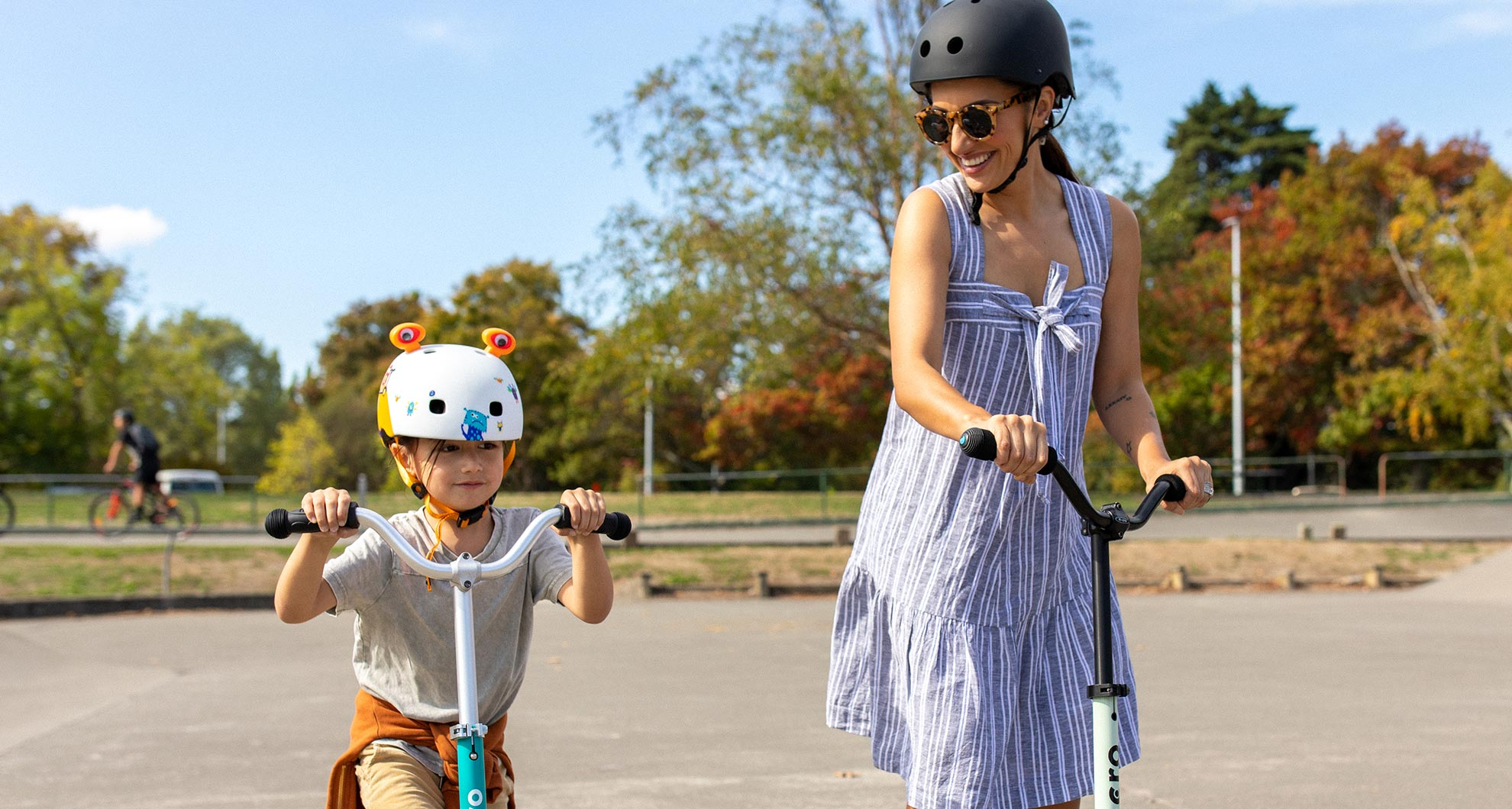 Mum and Child riding safety on their Micro Scooters
