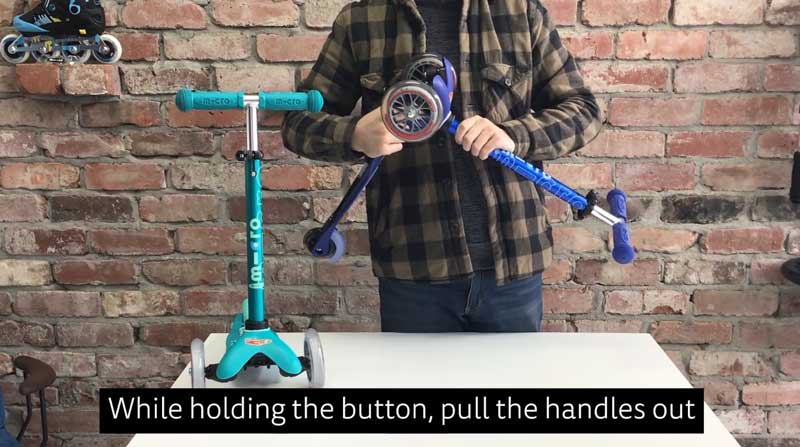 Press the button in while pulling the handlebar out