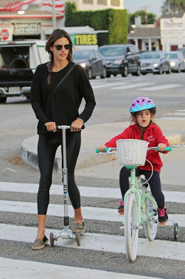 Allesandra Ambrosio's daughter scooting on a Micro Scooter