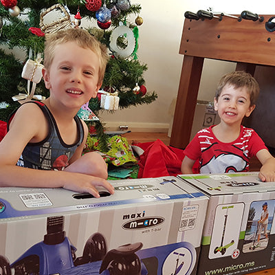 Brothers opening their xmas gifts
