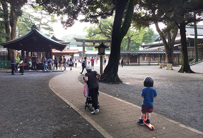 Boy on a mini micro in a park in Tokyo