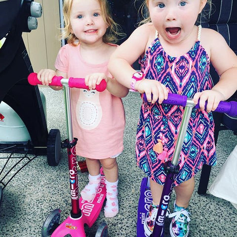 Girls excitement with their new mini micro scooters