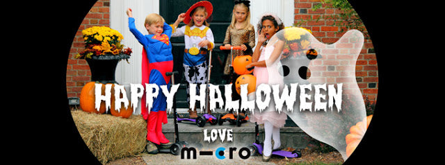 Kids in their Halloween costumes and their Micro Scooters