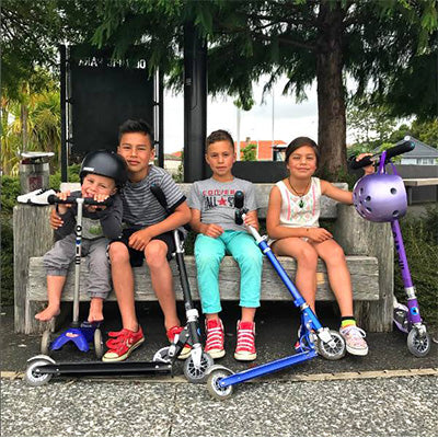 Kiwi family with their Micro Scooters