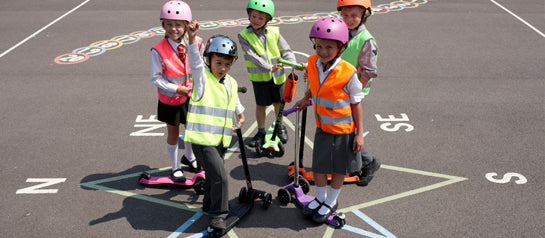 Kids on their Micro Scooters at school
