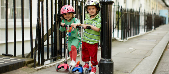 Two preschoolers having fun on their Micro scooters