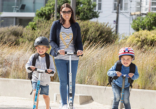 Mum scooting the school run with kids