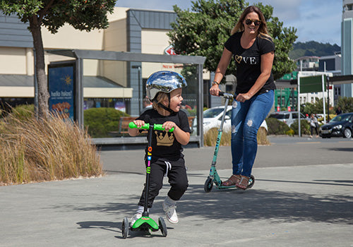 Mum scooting with her son using an adults scooter