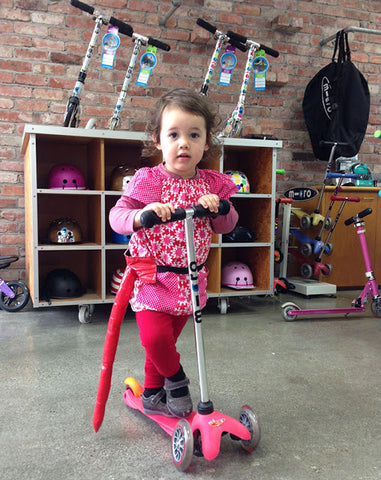 Pippa on her pink Mini Micro preschool scooter