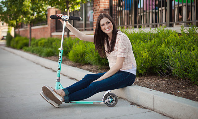 A woman with her Micro Scooter