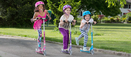 Kids having fun together on their Micro Scooters
