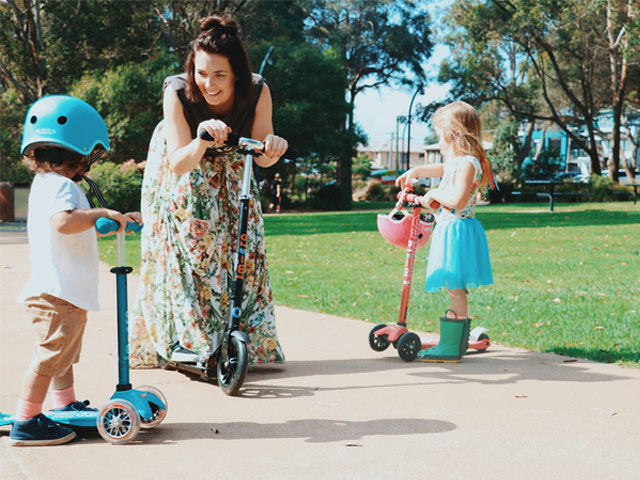 Mum scooting with her kids