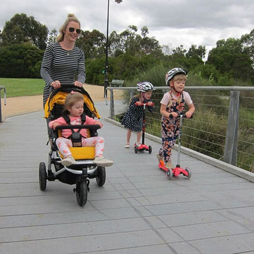 Adrienne scooting with her kids