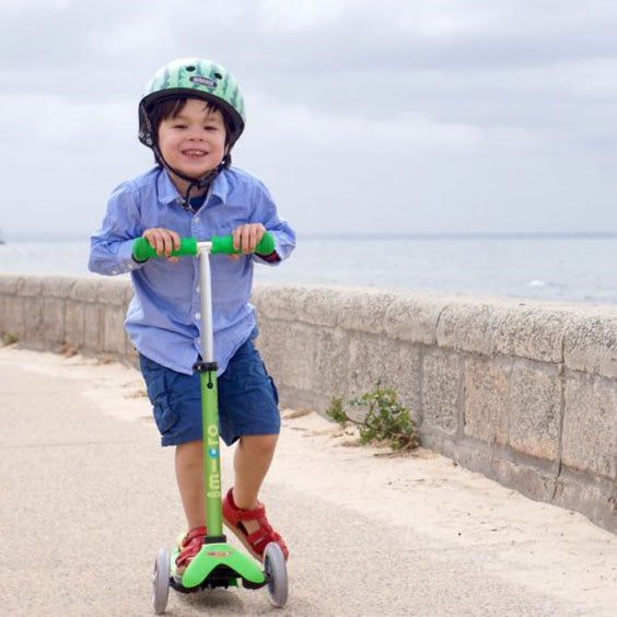 Little boy scooting on Mini Micro Deluxe