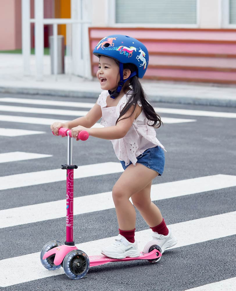 little girl on her awesome light up pink mini micro deluxe scooter