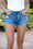 Beach Life Uneven Hem Denim Shorts (Bronze Button)